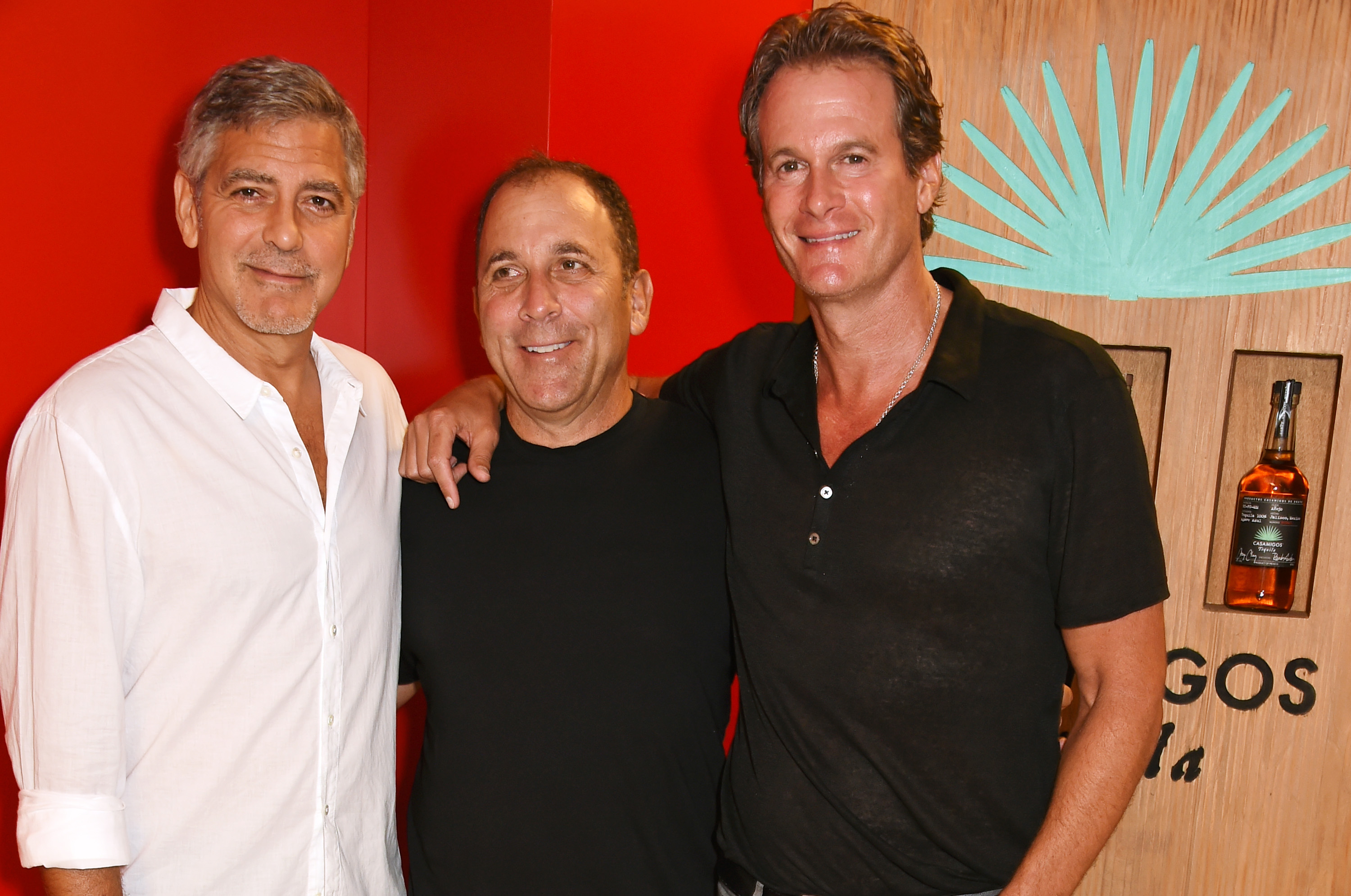 IBIZA, SPAIN - AUGUST 23: (L to R) Founders of Casamigos Tequila George Clooney, Mike Meldman and Rande Gerber attend as Casamigos founders Rande Gerber, George Clooney and Mike Meldman host the official launch of Casamigos Tequila in Ibiza and Spain at Ushuaia Ibiza Beach Hotel on August 23, 2015 in Ibiza, Spain. Pic Credit: Dave Benett