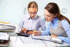 18729450-Concentrated-business-women-reviewing-accounting-report-Stock-Photo